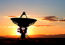 Sunrise at the very large array Radio telescope.